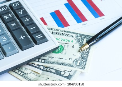 Pen ,bank note , calculator and finance graph analysis