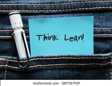 Pen and blue note in jeans pocket written THINK LEAN , a goal to creating most value to customer at minimum cost by minimizing resources , time , energy and effort