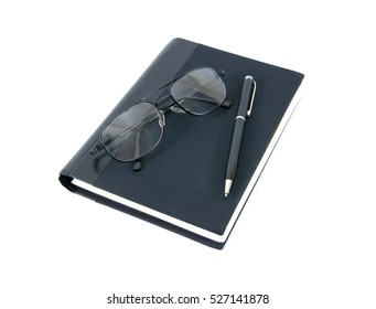 pen book and glasses isolated on white background