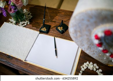 Pen and Book of wishes near gift box for wedding reception and expensive box decor arrangements at wedding ceremony. greeting for bride and groom. space for text. wedding reception