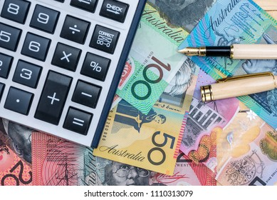 Pen and calculator on australian dollar banknotes
