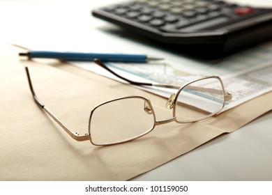pen and calculator on stocks