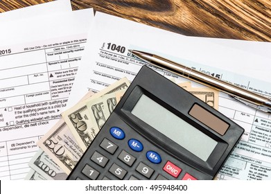 Pen with calculator on the tax form 1040
