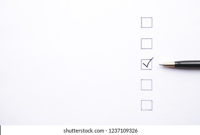 Pen and Checklist on white paper. Business concept
