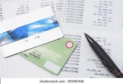 Pen and Credit card and Saving Account and Book Bank