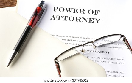 pen and glasses on power of attorney file