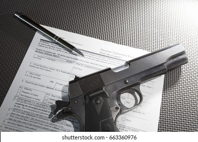 Pen and handgun with paperwork required to purchase the gun