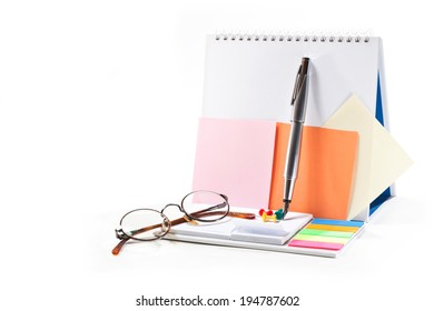 Pen with ink, glasses, sheets for records, tacks on white background