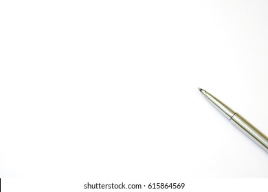 A pen laying down on a white paper background