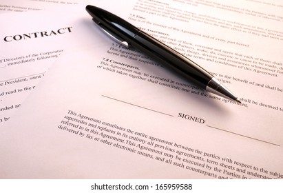 pen lying on a contract