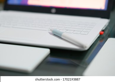 pen mouse on keyboard of notebook with copy space