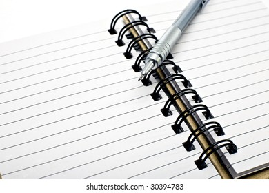 Pen with notebook.