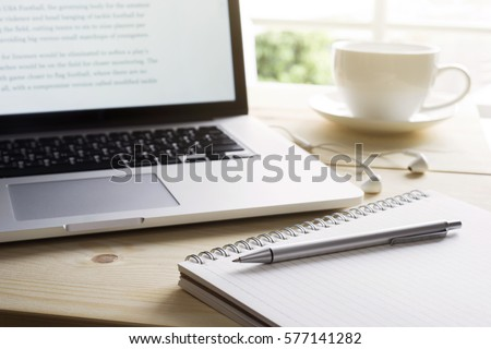 Pen and notebook with laptop.Inspiration moment,workspace or coffee break in the morning/ selective focus