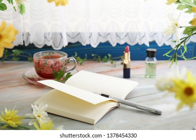 Pen and notebook on the table.