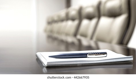 Pen and notepad on a table