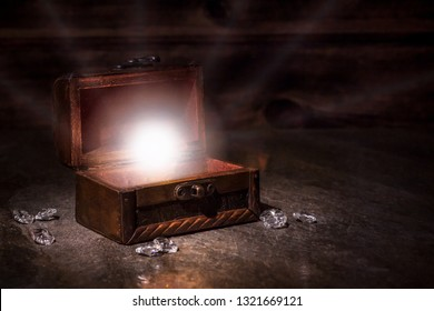 pen old pirate chest and whte light from it, brilliants, treausres in chest, pirate mystery, old magic, dream of traveler
