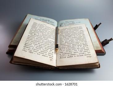 Pen on antique books