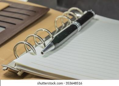 Pen on blank note paper.