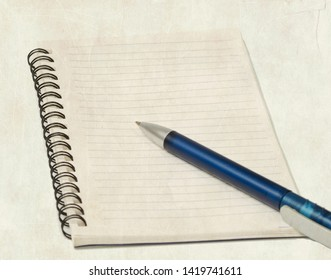 Pen on blank page of open notebook