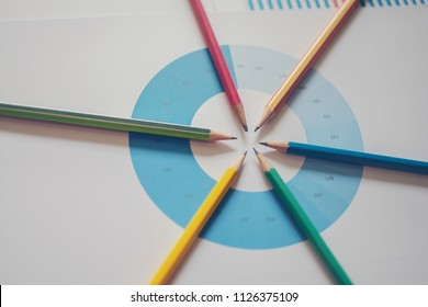 Pen on diagram chart and graphs business report with money, compass, calculator on desk of financial advisor. Accounting and Financial Planning Concept. top view.