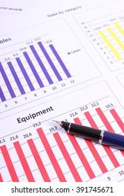 Pen on financial chart, business concept, analysis of sales plan, business report, business work station with paperwork