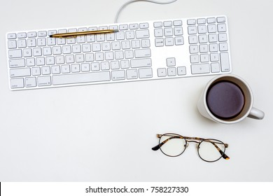 Pen on Keyboard Coffee Glasses White Desk From Above Top Down Overhead Flat Room for Text Minimal