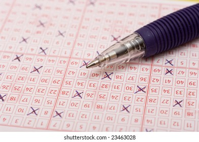 a pen is on a lottery ticket, macro