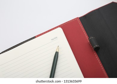 pen on note paper organizer