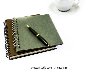 pen on notebook business  isolated on the white