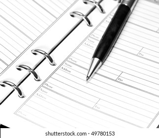 pen on notebook. close up shoot