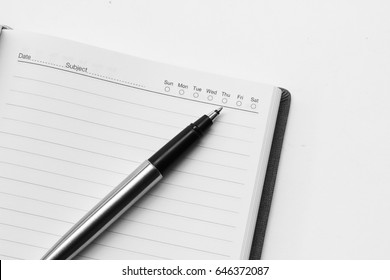 Pen on Notebook Isolated on the White Background
