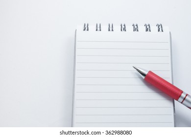 A pen on a notepad