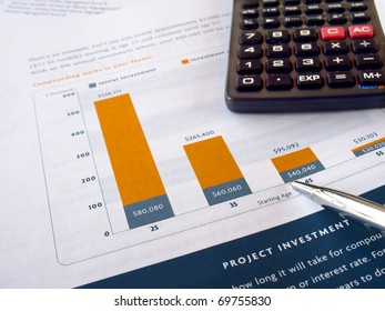 Pen on the project investment chart with calculator