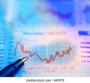 A pen on stocks chart of a newspaper