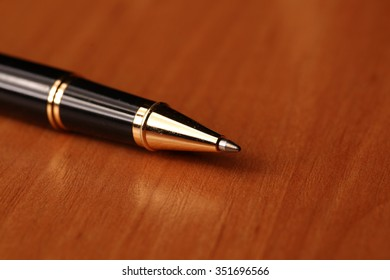 pen on the table. Macro image. warm tones