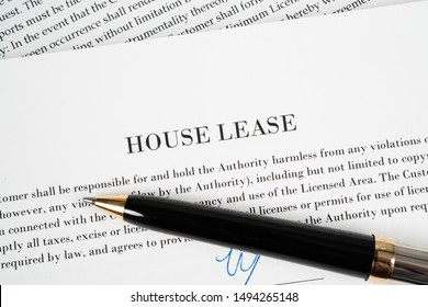Pen on top of a House Lease agreement just been signed