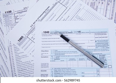 pen on US tax form background.tax day concept