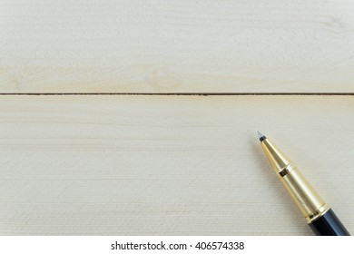 pen on wooden background