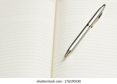 pen and open notepad, business still life