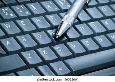 pen over laptop keyboard. Business concept