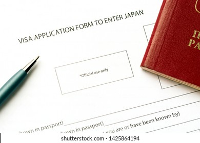 Pen and passport on blank Japan visa application form. Tourism and travel in Japan concept.