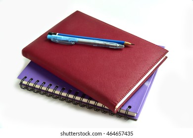 Pen. Pencil. and Notepad on the White background