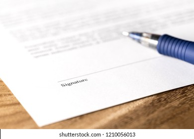 Pen and signature line on paper. Signing a business contract, legal agreement or rental deal for lease apartment. Offer for corporate acquisition, buyout or partnership. Hiring for work or employment.