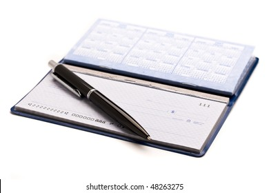 A pen sitting on top of an opened checkbook.