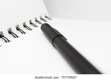 Pen and White Notebook