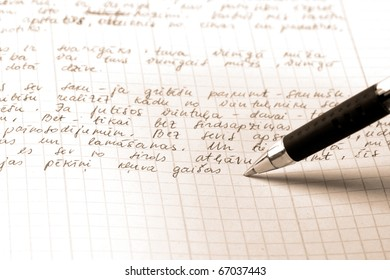 pen writes the text on a squared paper