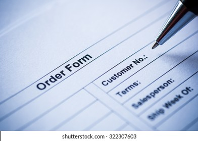 pen writing on order form.