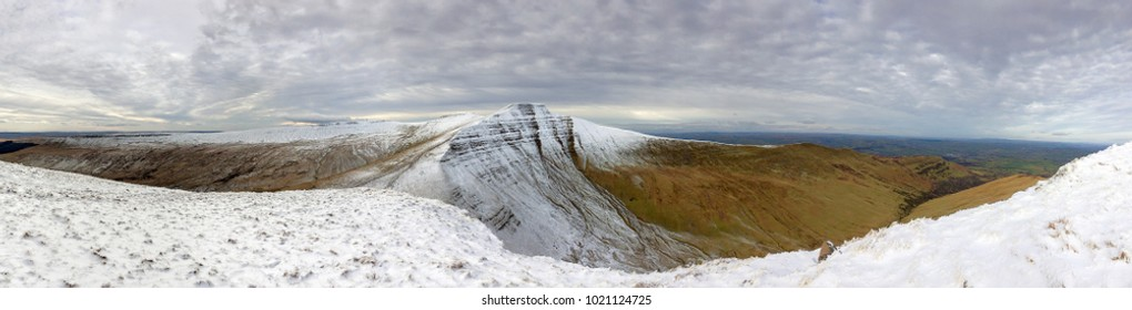 Pen y Fan and Corn Du are the highest mountains in the Brecon Beacons National Park. Panoramic format with winter snow.
