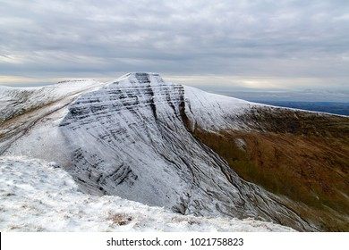 Pen y Fan and  Corn Du mountain with snow on the summit.