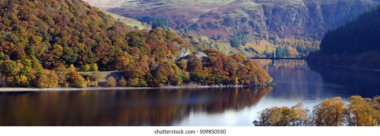 Pen Y Garreg reservoir autumn tree colours panorama